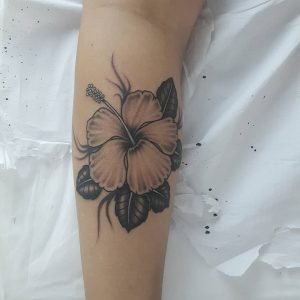 beautiful-flower-tattoo-in-black-on-a-woman