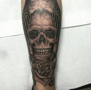 skull-and-rose-tattoo-on-leg